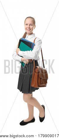 Cute girl in school uniform on white background