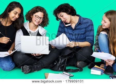 Group of Diverse Students Using Laptop Studio Portrait