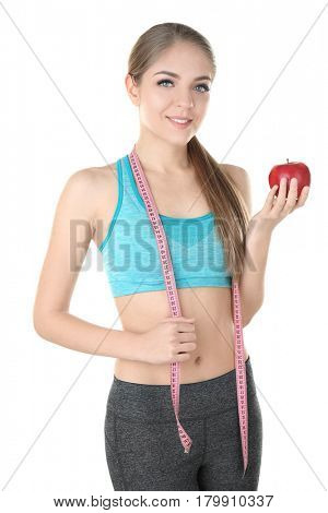 Diet concept. Young beautiful woman with apple and measuring tape on white background