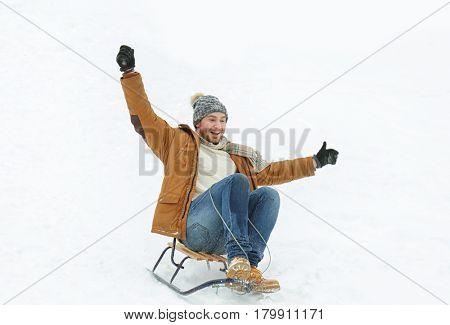 Man riding sleigh in winter park