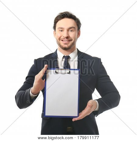 Handsome young man posing with clipboard on white background