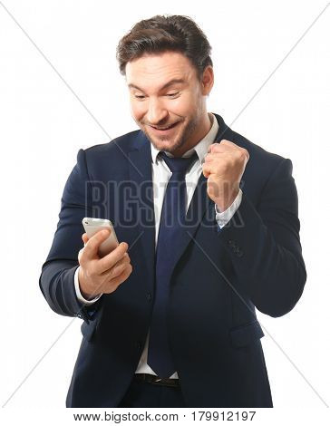 Handsome young man posing with phone on white background