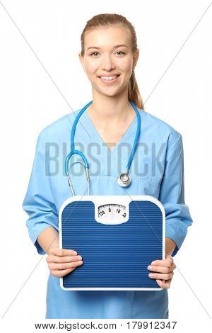 Diet concept. Female nutritionist with floor scales on white background