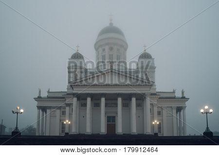 Helsinki Cathedral or St Nicholas Church shrouded in heavy fog Finland
