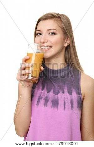 Beautiful young woman with glass of fresh juice on white background