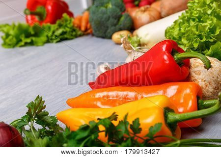 Vegetables. Lettuce salad, celery and pepper. Brocoli, onion and parsley. Organic food on wooden table.
