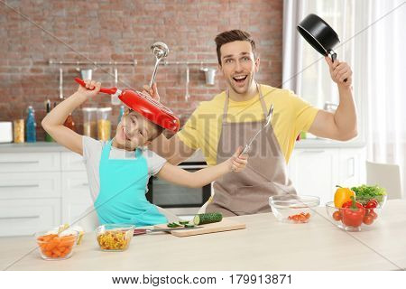 Dad and son cooking at home