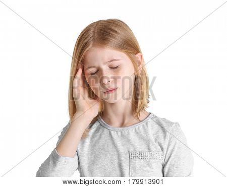 Cute girl suffering from headache on white background