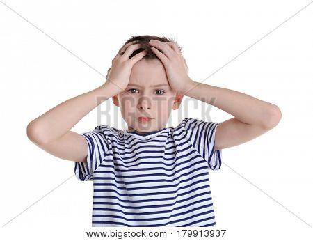 Cute boy suffering from headache on white background