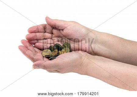 A small palm of coins in the hands of a pensioner