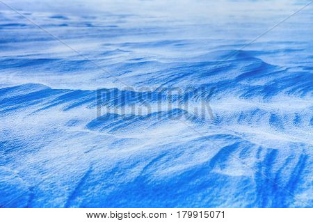 landscape with blue snowdrifts in the winter