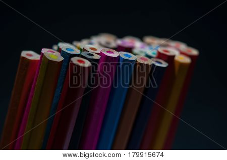 Colorful pencils background. Assortment of unsharpened multicolored crayons, macro view. School, sketching and drawing supplies.