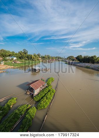 Traditional houseboat on natural river in Uthaithani Thailand