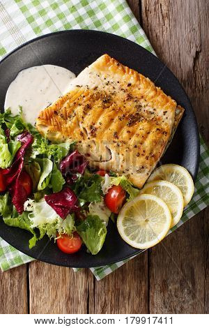 Fried Fillet Of Fish Arctic Char With Fresh Salad And Sauce Close-up. Vertical Top View