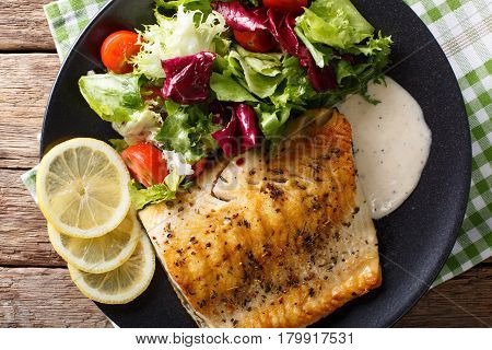 Grilled Char Fillet With Mixed Salad And Sauce On A Plate Close-up. Horizontal Top View