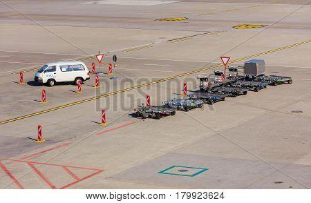 Kloten, Switzerland - 28 March, 2017: a van and carts in the Zurich Airport. The Zurich Airport, also known as the Kloten Airport, is the largest airport in Switzerland.
