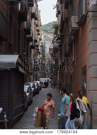 Naples, ITALY - may 17, 2015: migrants - illegal street trading, wide angle