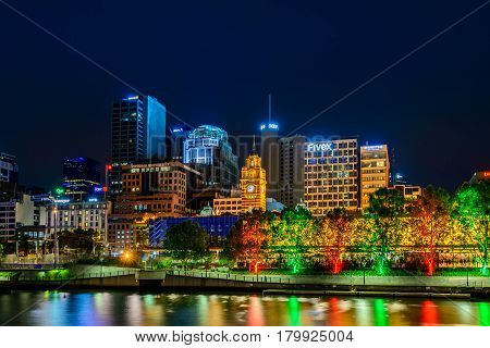 Melbourne Australia - December 27 2016: Melbourne city illuminated buildings with Railway Station in centre on a night viewed across the Yarra river