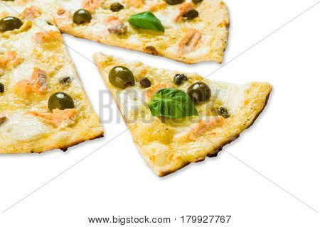 Italian seafood pizza with shrimps, calamari rings, capers and olives - thin pastry crust isolated at white background, one piece cut off, closeup