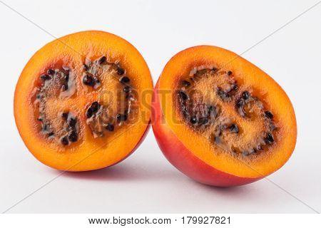 Exotic tropical fruit called tree tomato (Solanum Betaceum) on white background