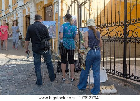Kiev Ukraine - June 16 2016: Artists paint a cityscape on the street St. Andrew's Descent