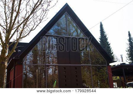 Modern single-family house with glass facade, red facade
