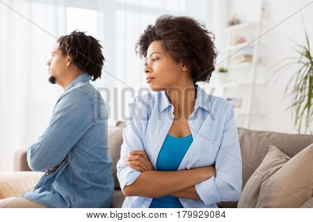 people, relationship difficulties, conflict and family concept - unhappy couple having argument r at home