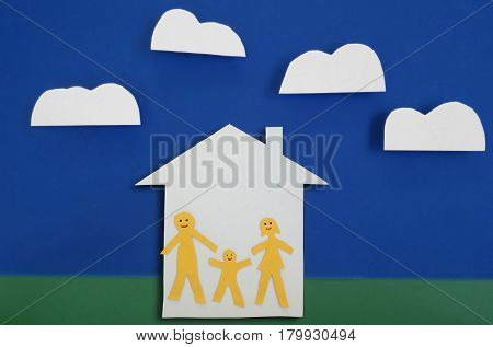 Happy paper family of three in house