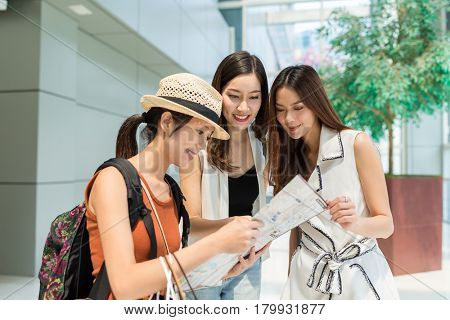Tourist asking for direction on city map from local people