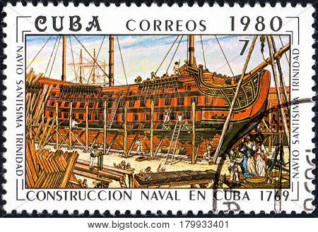 UKRAINE - CIRCA 2017: A postage stamp printed in Cuba shows shipbuilding on shipyard from series Constructing of ships on Cuba circa 1980