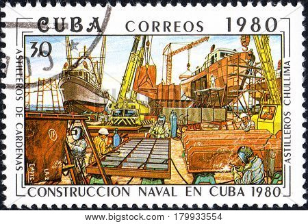 UKRAINE - CIRCA 2017: A postage stamp printed in Cuba shows Shipyards chullima from series Constructing of ships on Cuba circa 1980