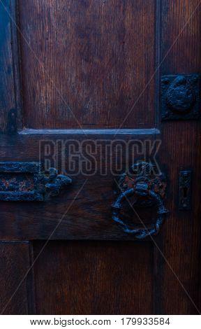 Old Iron Door Handle On Brown Natural Door, Rusty Decoration On Massive Door