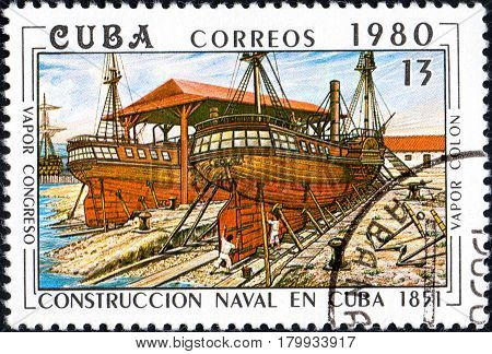 UKRAINE - CIRCA 2017: A postage stamp printed in Cuba shows shipyard from series Constructing of ships on Cuba circa 1980