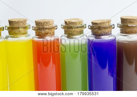 Colored liquids in five test tubes isolated over white background