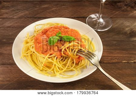 A photo of a plate of spaghetti with a fresh homemade tomato sauce, and a place for text
