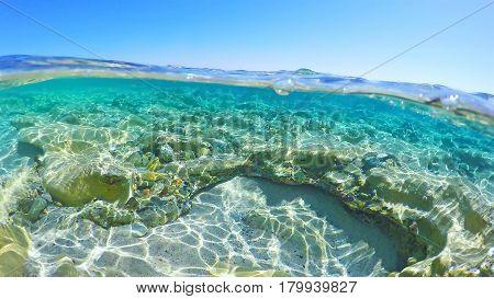 Split underwater in Piscina Rei in Sardinia