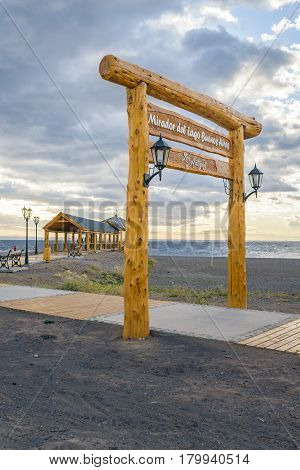 Rustic style signpost banner of viewpoint at lake in Los Antiguos a small town located at Santa Cruz province Argentina
