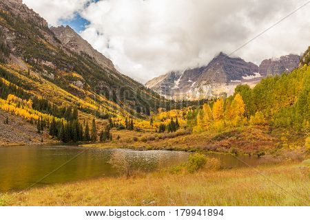 a reflection of the scenic maroon bells landscape in fall