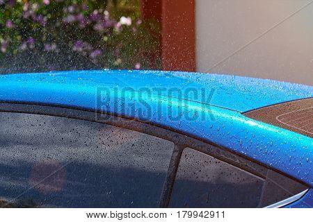 Wet Blue Car Roof