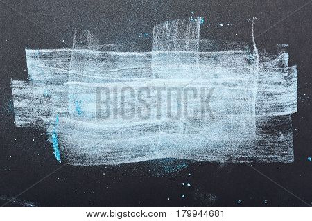 Artistic smeared white and blue Powder on dark Background with Place for Your Text