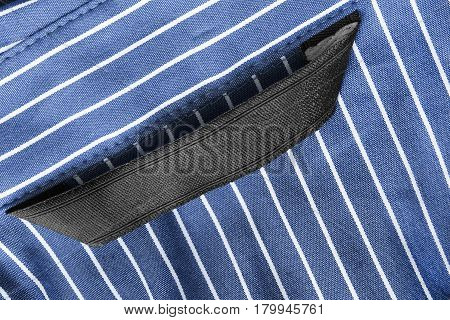 Blank black clothes label on blue striped cotton as a background
