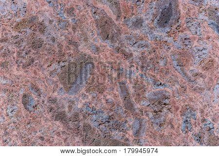 Polished volcanic basalt stone wall as texture