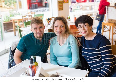 Mother with adult son and daughter indoors