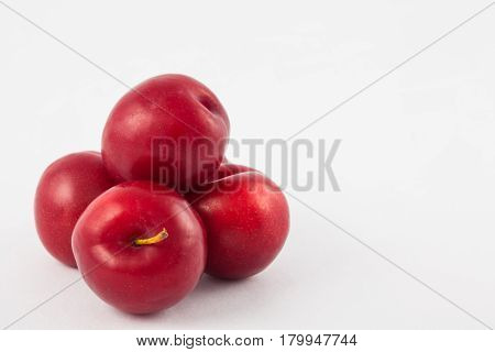 Plum ( Prunus domestica ) on white background