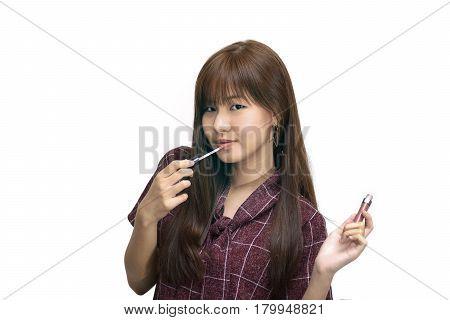 Girl Applying Matte Lipstick. Fashion Makeup Concept.