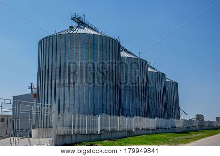 Giant metal silos keeping tons of wheat