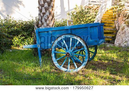 European vintage wagon. Decorative blue vintage cart