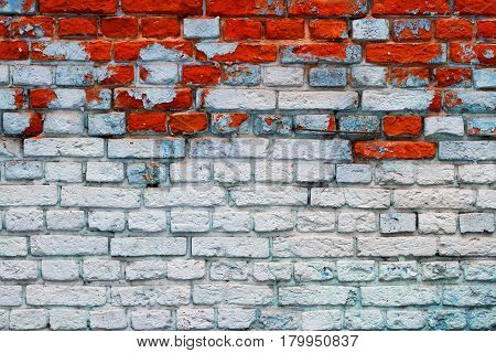 Brick wall with blue and red bricks (background texture)