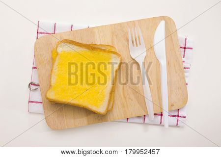 sweet toast butter meal on wooden chopping board with dish towel decoration on white background. this bread is thai style sweetmeat.