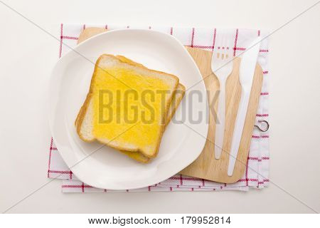 sweet toast butter meal on wooden chopping board on dish towel decoration on white background. this bread is thai style sweetmeat.